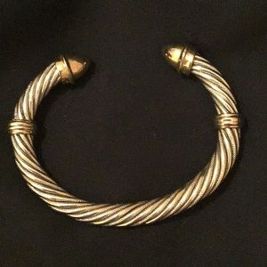 Silver bracelet with gold accents.